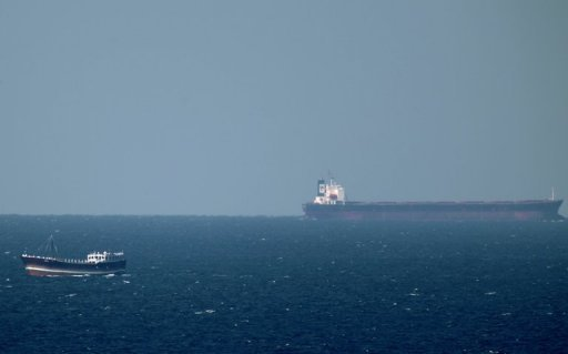An oil tanker cruises towards the Strait of Hormuz off the shores of Khasab in Oman in January 2012. A pipeline the UAE is building to pump oil from east coast terminals and bypass the Iran-threatened Strait of Hormuz will be fully operational in August, an Abu Dhabi oil official said Tuesday