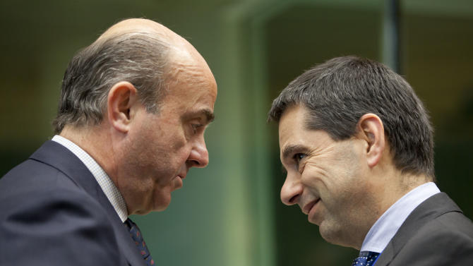 Euro ministers turn to Greece after banking deal