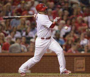Carpenter and Holliday lift Cards over Astros