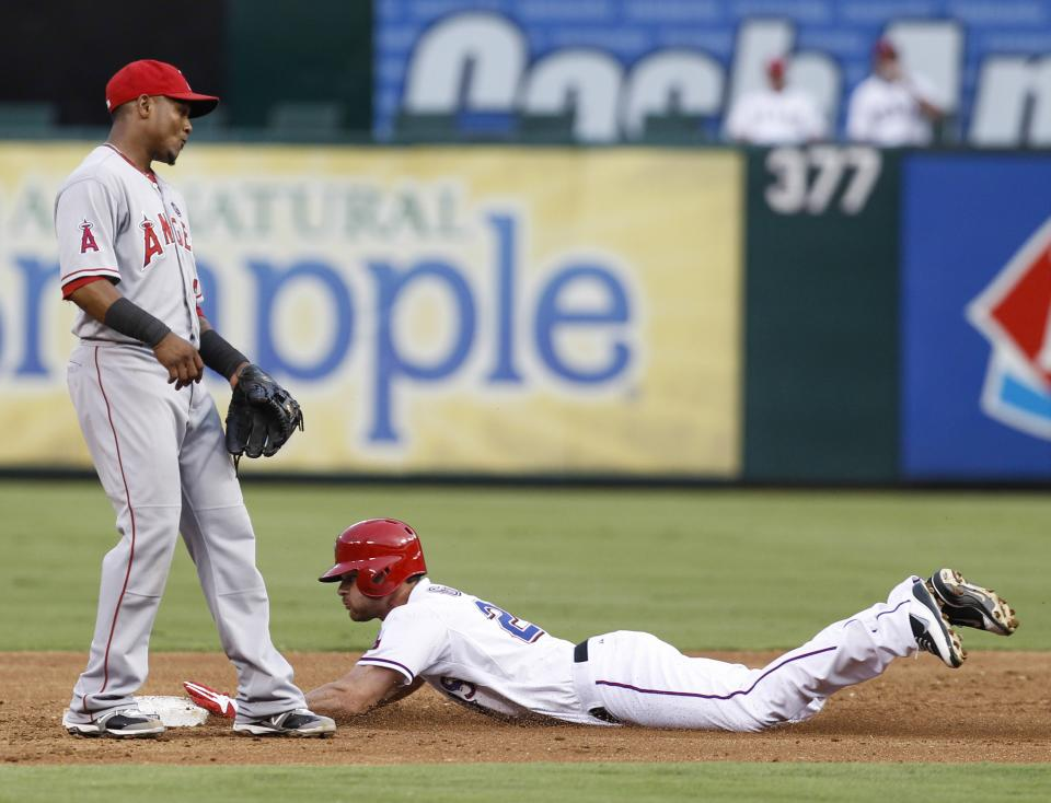 Martin homers in 10th as Rangers beat Angels 14-11