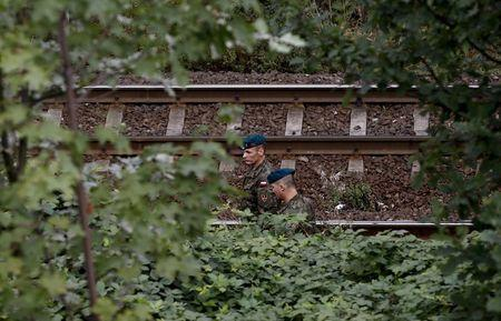 Soldiers from a demining team of the Centre for Training of Military Engineering and Chemical forces from Wroclaw inspect a site in an area where a Nazi train is believed to be at, in Walbrzych