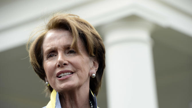House Minority Leader Nancy Pelosi of Calif. speaks to reporters outside the West Wing of the White House in Washington, Tuesday, April 1, 2014, following her lunch with President Barack Obama. Pelosi was asked several questions about the Affordable Care Act. (AP Photo/Susan Walsh)