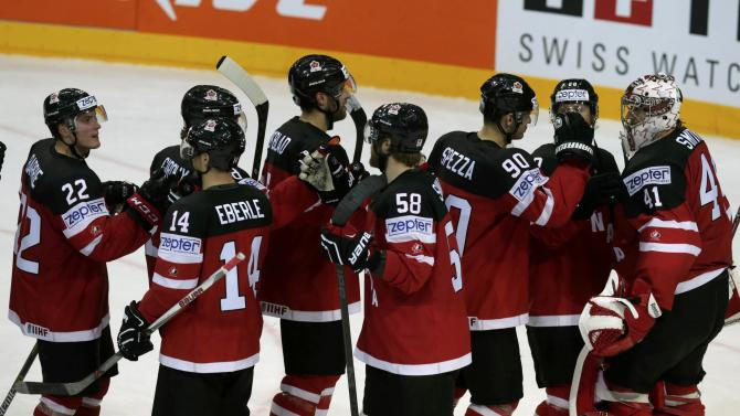 Canada's players celebrate after their Ice Hockey World Championship game against Sweden at the O2 arena in Prague