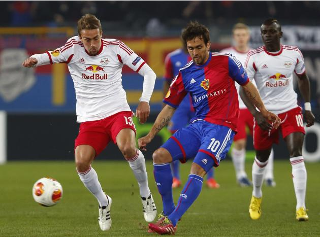 FC Basel's Delgado challenges Ilsanker of FC Salzburg during their Europa League round of 16 soccer match in Basel