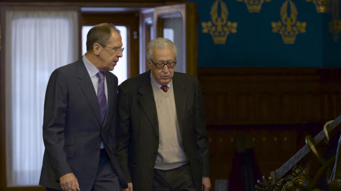 Russian Foreign Minister Sergey Lavrov, left, and U.N. envoy for Syria Lakhdar Brahimi talk during their meeting in Moscow, Russia, on Saturday, Dec. 29, 2012. (AP Photo/Ivan Sekretarev)