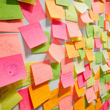 Wall-covered-in-colorful-post-it-notes_web