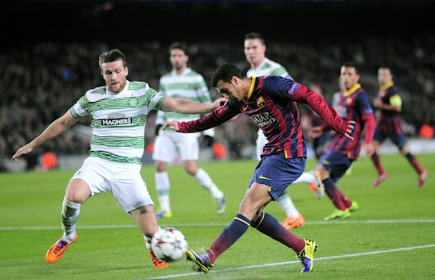 FC Barcelona's Pedro Rodriguez, right, duels for the ball against Celtic's Adam Matthews during a Champions League soccer match group H at the Camp Nou in Barcelona, Spain, Wednesday, Dec. 11,