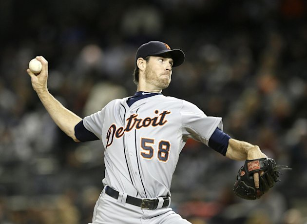 Detroit Tigers starting pitcher Doug Fister throws in the first inning during Game 1 of the American League championship series against the New York Yankees Saturday, Oct. 13, 2012, in New York. (AP Photo/Matt Slocum)
