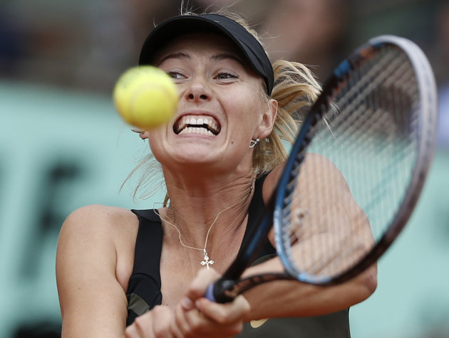 Maria Sharapova of Russia returns in the women's final match against Sara Errani of Italy at the French Open tennis tournament in Roland Garros stadium in Paris, Saturday June 9, 2012. (AP Photo/Berna