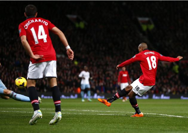 Manchester United's Ashley Young scores a goal against West Ham during their English Premier League soccer match in Manchester