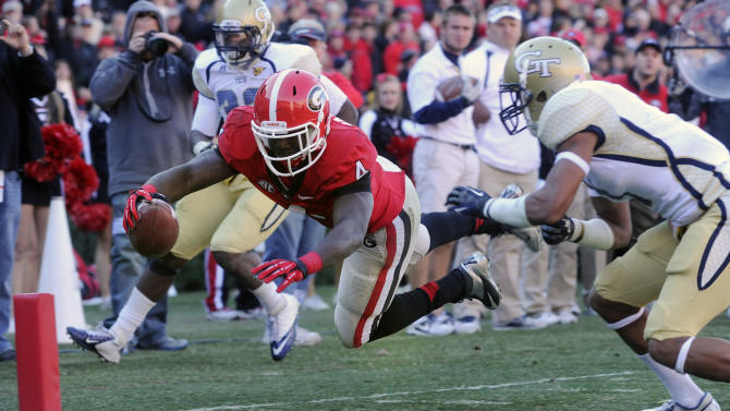 Georgia running back Keith Marshall (4) dives for a touchdown as Georgia Tech safety Isaiah Johnson defends during the third quarter of an NCAA college football game, Saturday, Nov. 24, 2012, in Athens, Ga. Georgia won 42-10. (AP Photo/John Amis)
