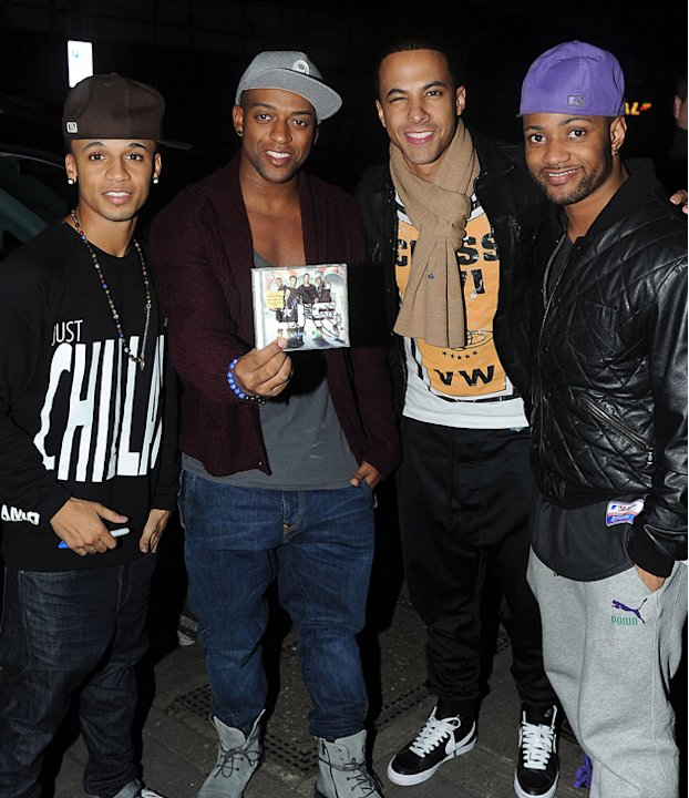 JLS pose with their debut album - which also hit number one. Copyright [WENN]