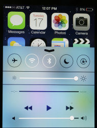 An iPhone with iOS 7 software displays the new look of the Control Center, Tuesday, Sept. 17, 2013 in New York. Much of the new iOS 7 software is about cosmetic changes. (AP Photo/Mark Lennihan)