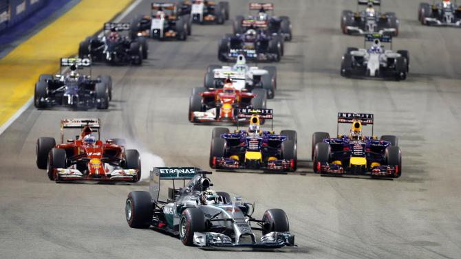 Mercedes Formula One driver Lewis Hamilton of Britain leads the pack of drivers at the start of the Singapore F1 Grand Prix at the Marina Bay street circuit in Singapore