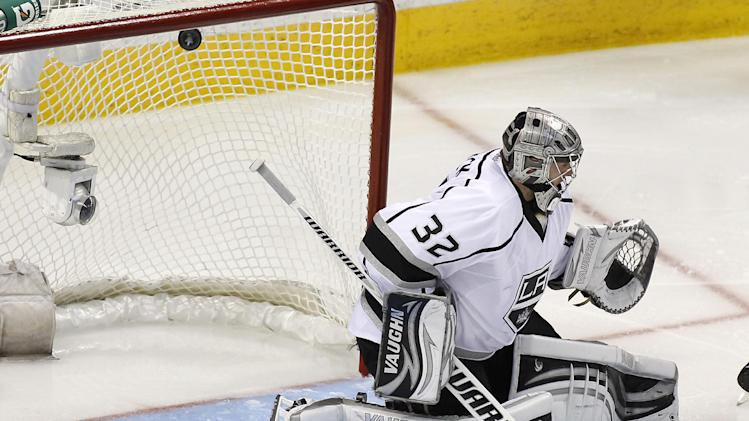 Los Angeles Kings goalie Jonathan Quick (32) is scored on by San Jose Sharks center Logan Couture (39) (not seen) during overtime in Game 3 of their second-round NHL hockey Stanley Cup playoff series, Saturday, May 18, 2013, in San Jose, Calif. San Jose won in overtime 2-1. (AP Photo/Tony Avelar)