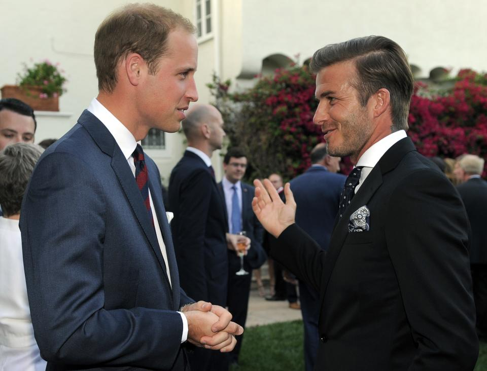 Prince William, Duke of Cambridge, mingles with soccer player David Beckham during a private reception at the British Consul-General's residence in Los Angeles, Friday, July 8, 2011. (AP Photo/Chris Pizzello, Pool)
