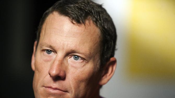FILE - In this Feb. 15, 2011, file photo, Lance Armstrong pauses during an interview in Austin, Texas. Armstrong is being sued for more than $1.5 million by a British newspaper which lost a libel action for publishing doping allegations against the now-disgraced cyclist. The Sunday Times paid Armstrong 300,000 pounds (now about $485,000) in 2006 to settle a case after it reprinted claims from a book in 2004 that he took performance-enhancing drugs. (AP Photo/Thao Nguyen, File)