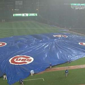 Grounds crew battles tarp