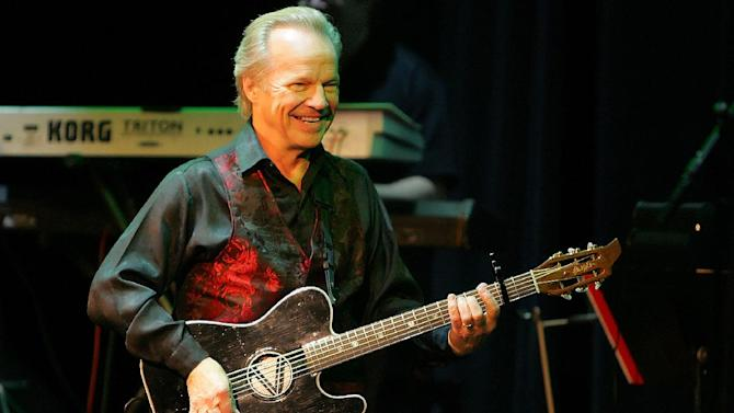 FILE - In this Dec. 18, 2009, file photo, Bobby Vee performs at the Mississippi Moon Bar in Dubuque, Iowa.  Born Robert Velline 69 years ago in Fargo, N.D., the former teen idol who recorded a string of pop music hits in the 1960s  says he's been diagnosed with Alzheimer's disease. (AP Photo/Telegraph Herald, Jeremy Portje) MAGS OUT, TV OUT