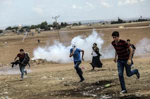 Turkish police and soldiers clash with protesters near…