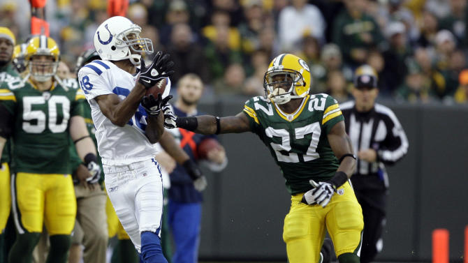FILE - In this Oct. 19, 2008, file photo, Indianapolis Colts Marvin Harrison, left, makes a catch as Green Bay Packers' Will Blackmon defends during an NFL football game in Green Bay, Wis. Harrison is a finalist for the Pro Football Hall of Fame. (AP Photo/Morry Gash, File)