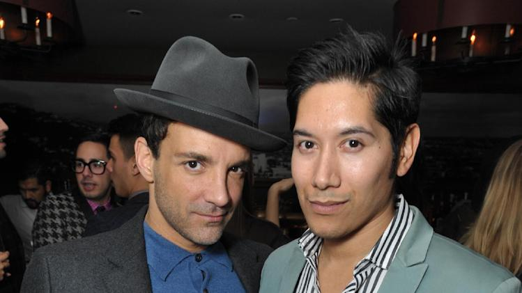 George Kotsiopoulos, left, and Carlos Lopez attend the DETAILS Hollywood Mavericks Party hosted by Dan Peres at Soho House on Thursday, Dec. 5, 2013, in West Hollywood, Calif. (Photo by John Shearer/Invision for DETAILS Magazine/AP Images)