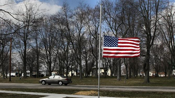 CORRECTS DAY OF EXPLOSION TO MONDAY INSTEAD OF TUESDAY - Marine Aaron Ripperda of Highland, Ill. is remembered with flags at half mast in nearby downtown Marine, Ill., where his father lives, Wednesday, March 20, 2013. Ripperda was killed with six other Marines in an explosion during a Nevada training exercise on Monday. (AP Photo/St. Louis Post-Dispatch, Robert Cohen)  EDWARDSVILLE INTELLIGENCER OUT; THE ALTON TELEGRAPH OUT