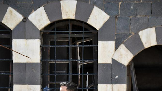In this Friday, April 20, 2012 photo, a Free Syrian Army fighter smokes a cigarette in Homs, Syria.  (AP Photo)