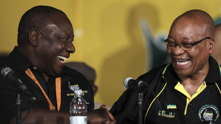 African National Congress (ANC) re-elected President Jacob Zuma, right, shares a moment with his deputy Cyril Ramaphosa, left, during their elective conference at the University of the Free State in Bloemfontein, South Africa, on Tuesday, Dec. 18, 2012. South Africa's governing African National Congress voted overwhelmingly Tuesday to keep President Jacob Zuma as the head of the nation's dominant political force, more than likely guaranteeing the politician another five years in the country's presidency. Zuma trounced Deputy President Kgalema Motlanthe, his only challenger who ran a largely muted and reluctant campaign, getting 2,983 votes to Motlanthe's 991. A smiling Zuma came to the stage immediately after the announcement, waving at the cheering crowd with both hands. (AP Photo/Themba Hadebe)