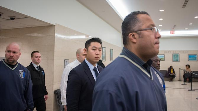 New York City Police Officer Peter Liang, center, arrives for closing arguments at his Brooklyn Supreme Court trial in the shooting death of Akai Gurley, Tuesday, Feb. 9, 2016.  Liang says he didn't know anyone was in the pitch-black stairway when he unintentionally fired. The shot ricocheted off a wall and hit  Gurley, who was taking the stairs down rather than wait for an elevator.  (AP Photo/Bryan R. Smith)