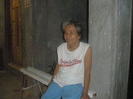 My mother-in-law in front of the new Cebu home.