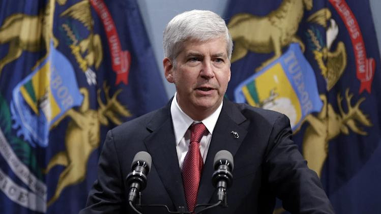 Gov. Rick Snyder speaks at a news conference in Lansing, Mich., Tuesday, Dec. 11, 2012. Michigan became the 24th state with a right-to-work law after Snyder signed the bill Tuesday. (AP Photo/Paul Sancya)
