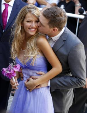 """Canadian pop star Michael Buble kisses his bride Argentine TV actress Luisana Lopilato after their brief civil wedding in Buenos Aires, Argentina, Thursday March 31, 2011. The Grammy-winning singer of """"Crazy Love"""" and his Argentine sweetheart posed for a mob of fans after tying the knot. They plan a full ceremony with 300 guests next month at a mansion outside Buenos Aires, followed by another wedding in Vancouver in April. (AP Photo/Natacha Pisarenko)"""