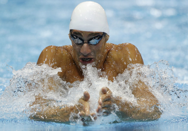 Syria's Azad Al Barazi swims in a men's 100-meter breaststroke heat at the Aquatics Centre in the Olympic Park during the 2012 Summer Olympics in London, Saturday, July 28, 2012. (AP Photo/Michael Sohn)