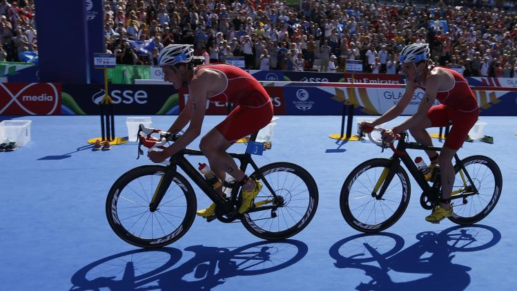 England's Jonathan Brownlee follows his brother Alistair Brownlee during the cycling portion of the men's triathlon race at the 2014 Commonwealth Games in Glasgow, Scotland