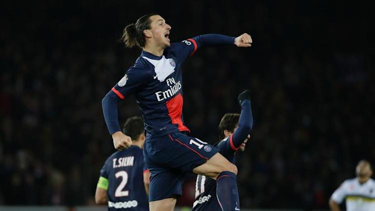 Paris Saint-Germain's forward Zlatan Ibrahimovic celebrates after scoring during the French L1 football match against Sochaux at the Parc des Princes Stadium in Paris on December 7, 2013
