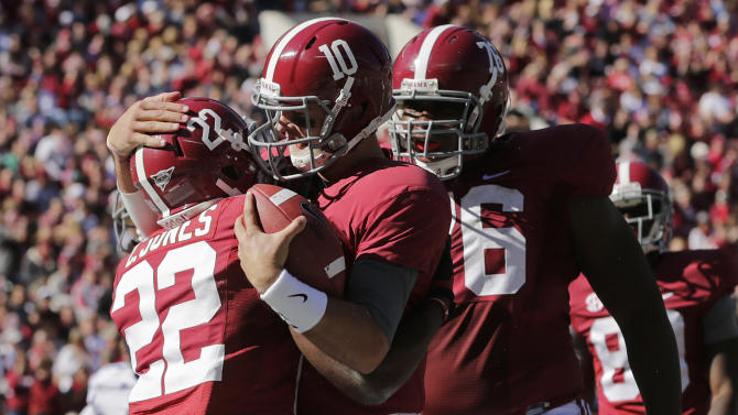 Alabama quarterback AJ McCarron (10) hugs teammate Alabama wide receiver Christion Jones (22) after throwing him a 29 yard touchdown pass during the first half of an NCAA college football game against Western Carolina at Bryant-Denny Stadium in Tuscaloosa, Ala., Saturday, Nov. 17, 2012. At right is Alabama offensive lineman D.J. Fluker (76). (AP Photo/Dave Martin)