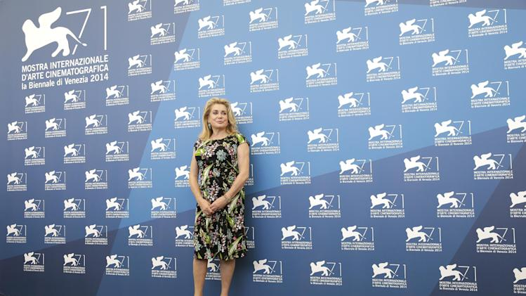 Catherine Deneuve poses during the photo call for the movie '3 Coeurs' at the 71st edition of the Venice Film Festival in Venice, Italy, Saturday, Aug. 30, 2014. (AP Photo/Andrew Medichini)