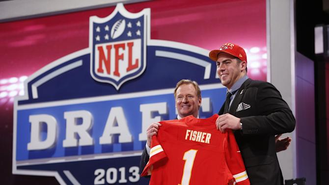Eric Fisher, from Central Michigan, stands with NFL Commissioner Roger Goodell after being selected first overall by the Kansas City Chiefs in the first round of the NFL football draft, Thursday, April 25, 2013, at Radio City Music Hall in New York. (AP Photo/Jason DeCrow)