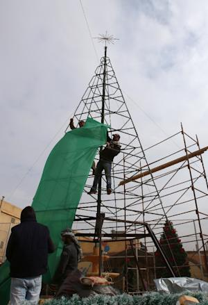 Local residents build a Christmas tree in Sadad, a…