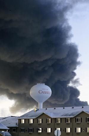 A fireball goes up at the site of an oil train derailment…
