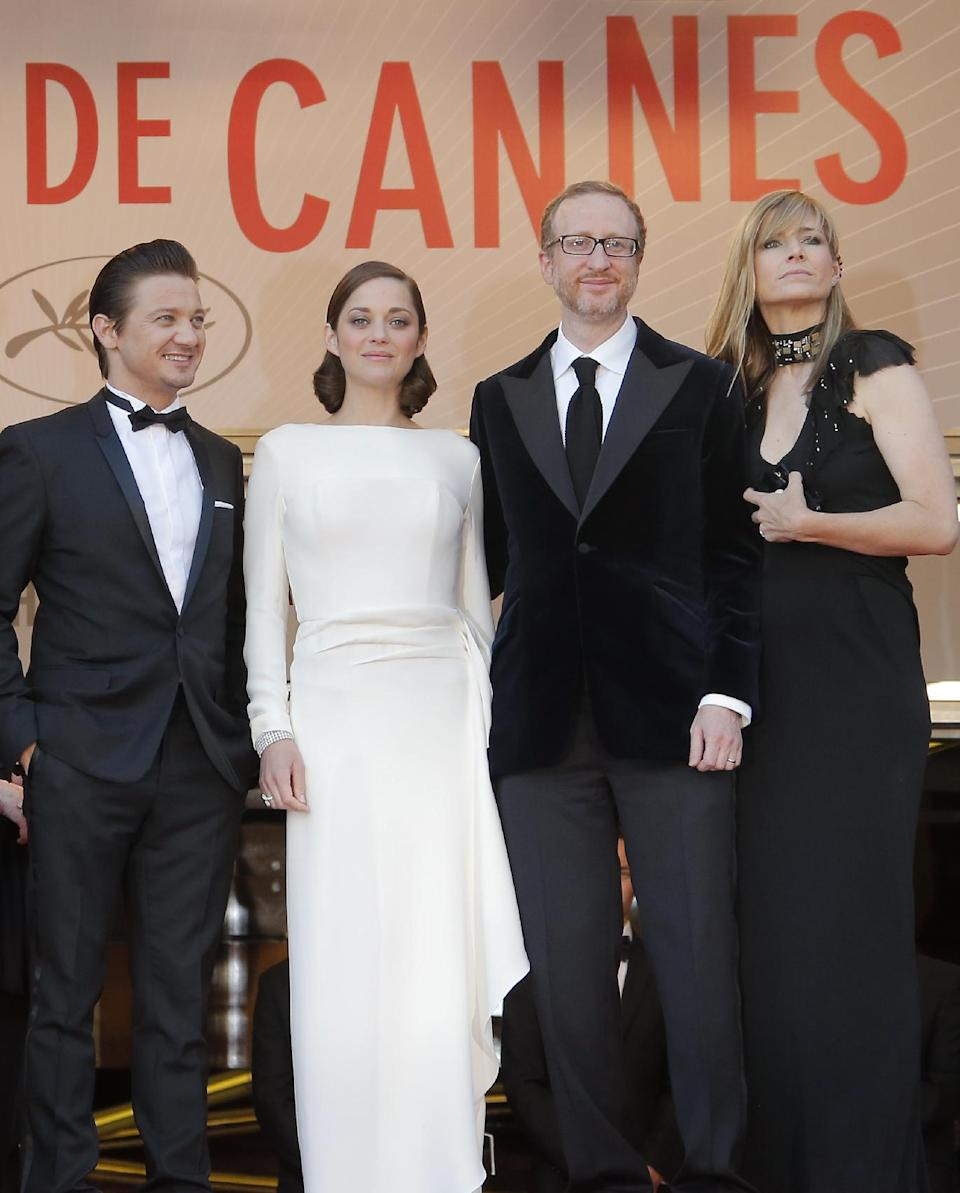 From left, actors Jeremy Renner, Marion Cotillard, director James Gray and his wife Ali Gray arrive for the screening of the film for the screening of The Immigrant at the 66th international film festival, in Cannes, southern France, Friday, May 24, 2013. (AP Photo/Francois Mori)