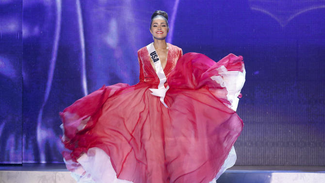 Miss USA, Olivia Culpo, walks on stage during a performance by Australian singer Timomatic, during the Miss Universe pageant, Wednesday, Dec. 19, 2012, in Las Vegas. Culpo was crowned as Miss Universe. (AP Photo/Julie Jacobson)