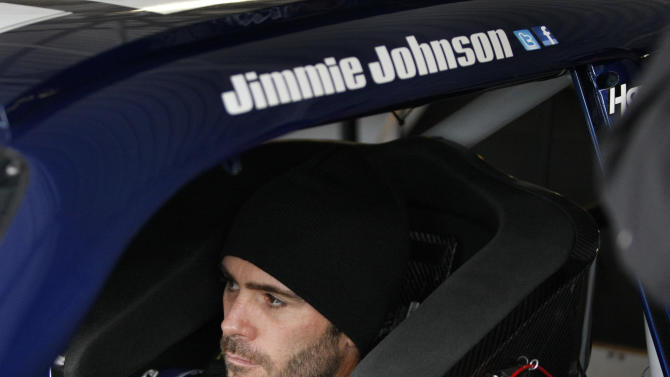 Driver Jimmie Johnson sits in his car during practice for the NASCAR Sprint Cup Series auto race at Kansas Speedway in Kansas City, Kan., Thursday, Oct. 18, 2012. (AP Photo/Colin E. Braley)
