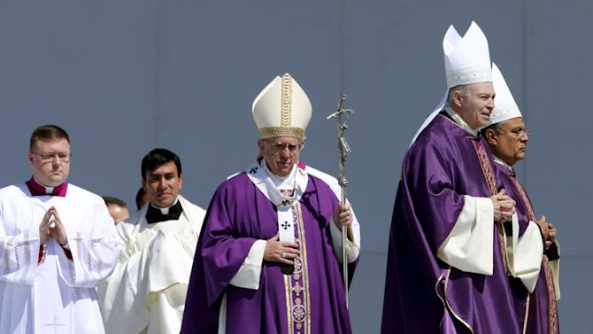 Pope Francis celebrates a Mass before a crowd of hundreds of thousands in Ecatepec, Mexico,
