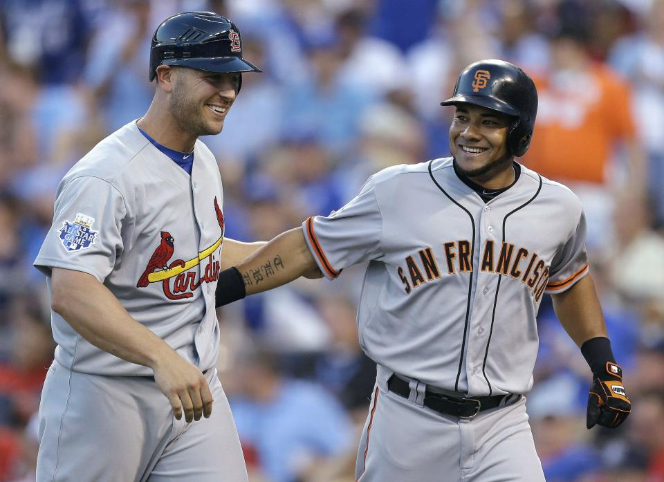 National League's Melky Cabrera, right, of the San Francisco Giants, celebrates his two-run home run with Matt Holliday, of the St. Louis Cardinals, during the fourth inning of the MLB All-Star baseball game, Tuesday, July 10, 2012, in Kansas City, Mo. (AP Photo/Jeff Roberson)