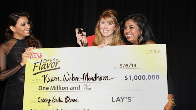 """IMAGE DISTRIBUTED FOR FRITO-LAY - In this photo released on Monday, May 6, 2013 in Los Angeles, actress Eva Longoria, left, and Frito-Lay Chief Marketing Officer Ann Mukherjee, right, pose with the grand prize winner of the Lay's """"Do Us A Flavor"""" contest, Karen Weber-Mendham, center, who submitted the winning flavor idea, Lay's Cheesy Garlic Bread. The special event was held at Longoria's Beso restaurant.  (Photo by Matt Sayles/Invision for Frito-Lay/AP Images)"""