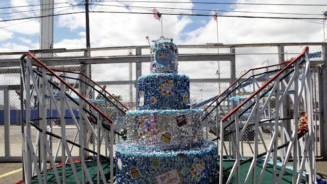 In a Tuesday, June 26, 2012 photo taken on Coney Island in New York,  a float marking the Cyclone roller coaster's 85th anniversary and used in the Mermaid Parade  is seen in the ride's lot.   The New York City landmark and international amusement icon will be feted Saturday, June 30 with a birthday party in its honor.   (AP Photo/Mary Altaffer)