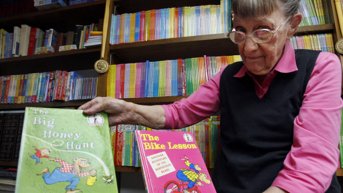 FILE - Jan. 25, 2011 file photo, Janice Berenstain displays a copy of the first book, left, she and husband, Stanley Berenstain, created and the second book, which was the first to actually call the characters Berenstain Bears, in Solebury, Pa. Jan Berenstain, who with her husband Stan created the Berenstain Bears books that have charmed preschoolers and their parents for 50 years, has died. Her son Mike Berenstain said she died Feb. 24, 2012.  She was 88.  (AP Photo/Mel Evans)