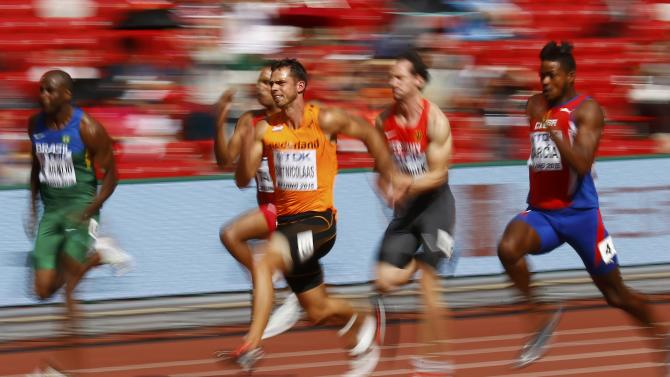 Eelco Sintnicolaas of Netherlands (C) competes in the 100 metres decathlon event during the 15th IAAF World Championships at the National Stadium in Beijing
